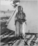 lossy-page1-220px-Angelic_La_Moose,_whose_grandfather_was_a_Flathead_chief,_wearing_costume_her_mother_made,_full-length,_standing,_in_fro_-_NARA_-_519156.tif